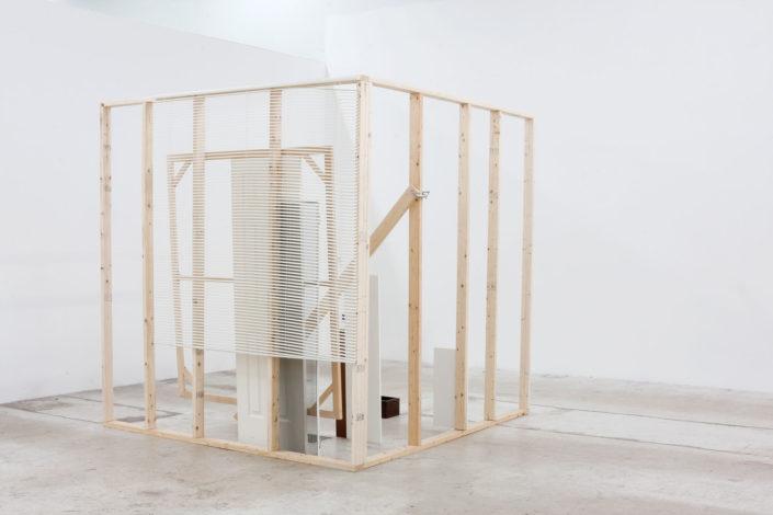 Leyden Rodriguez-Casanova. A Corner Structure Assemblage, 2014. Blinds, screen, door, MFD, particle board, steel. Dimensions variable.