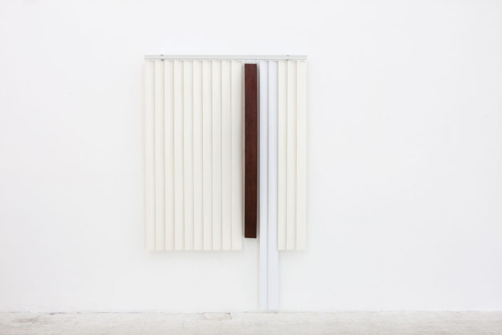 Leyden Rodriguez-Casanova. Blinds and Wooden Arc, 2013. PVC vertical blinds, aluminum, wood. 84 x 53 x 8 in, 213.36 x 134.62 x 20.32 cm.
