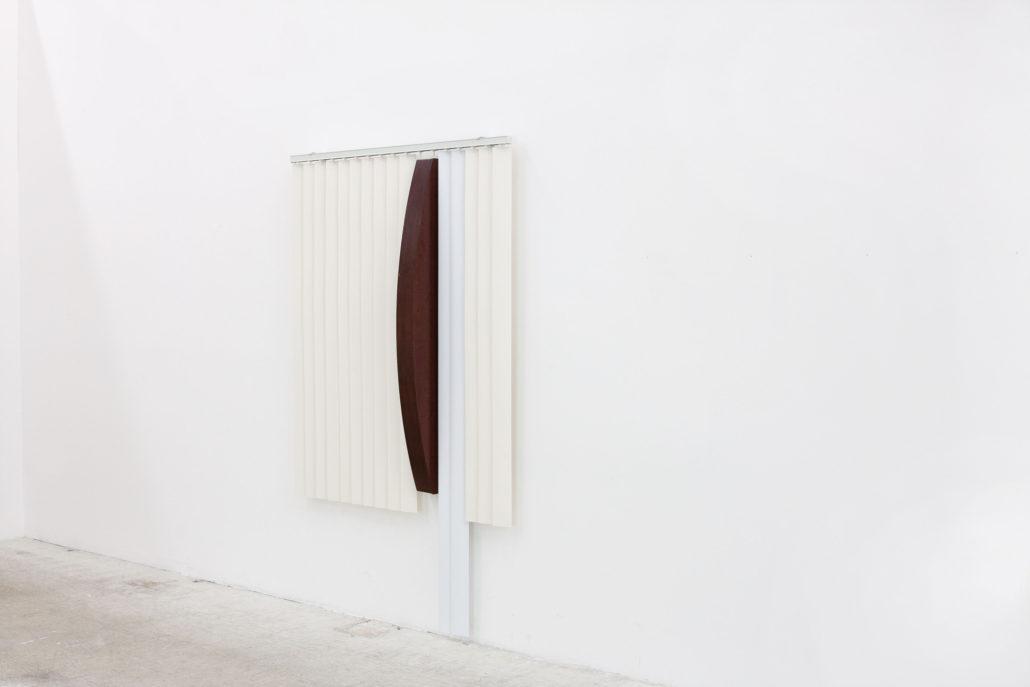 Leyden Rodriguez-Casanova. Blinds and Wooden Arc, 2013. PVC vertical blinds, aluminum, wood. 84 x 53 x 8 in, 213.36 x 134.62 x 20.32 cm.