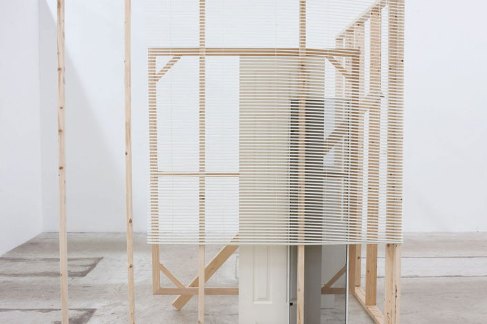 Leyden Rodriguez-Casanova. A Corner Structure Assemblage, 2014. Blinds, screen, door, MFD, particle board, steel. Dimensions variable.