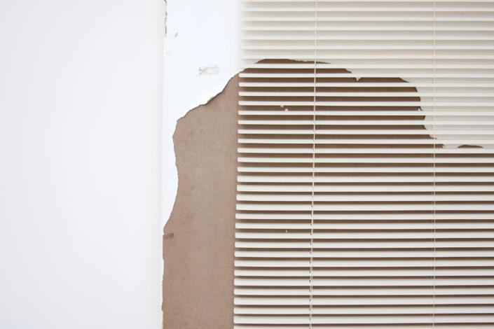 Leyden Rodriguez-Casanova. A Degraded Door and Blinds, 2012. Found door, PVC blinds, steel. 36 x 80 x 12 in, 91.44 x 203.2 x 30.48 cm.