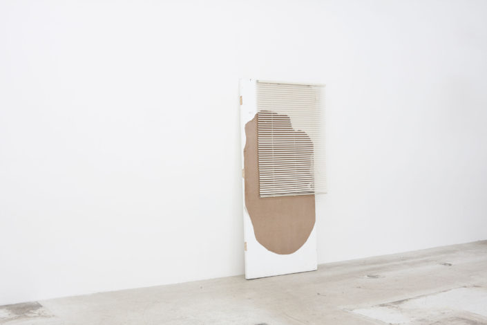 Leyden Rodriguez-Casanova. A Degraded Door and Blinds, 2012. Found door, PVC blinds, steel. 36 x 80 x 12 in, 91.44 x 203.2 x 30.48 cm.