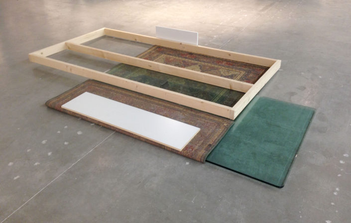 Leyden Rodriguez-Casanova. An Area Rug, Glass Pane and Wooden Structure Put in Place, 2015. Rug, glass, wood, particle board, laminate. Dimensions variable. Site specific work, Museum of Contemporary Art, North Miami.