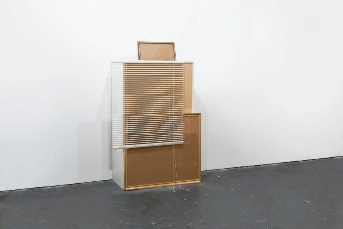 Leyden Rodriguez-Casanova. Blinds, a Shelf and Frames, 2012. MDF, plywood, wood, glass, PVC blinds, metal. Dimensions variable.