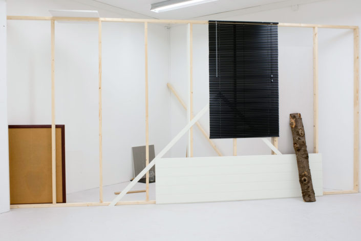 Leyden Rodriguez-Casanova. Sectioned Composition, 2014. Aluminum blinds, wood, plexiglass, glass, steel, particle board, laminate, paint. Dimensions variable. Site specific installation, Prosjektrom Normanns, Stavanger, Norway.