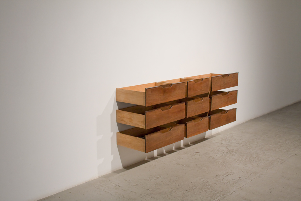 Leyden Rodriguez-Casanova. Nine Drawers Left, 2009. Found wood drawers, steel. Dimensions variable. Collection of Pérez Art Museum Miami (PAMM).