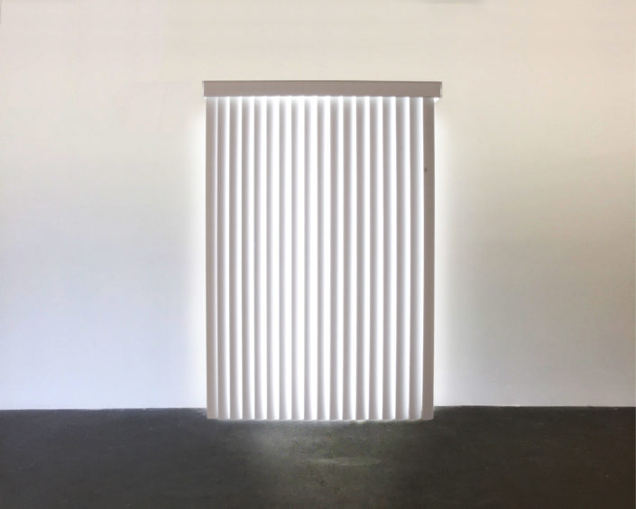 Leyden Rodriguez-Casanova. White Light Blinds, 2007. PVC vertical blinds, custom lightbox. 80 x 48 x 12 in, 203.2 x 121.92 x 30.48 cm.