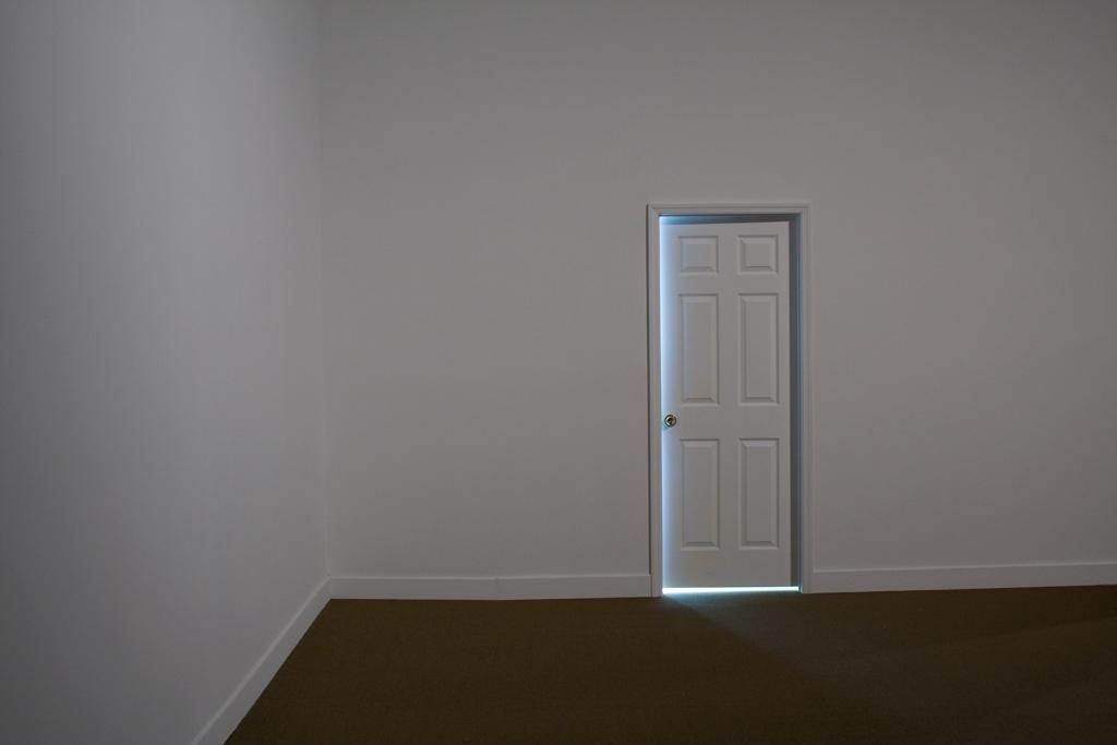 Leyden Rodriguez-Casanova. A Seemingly Open Door, 2008. Wood, MDF, metal, fluorescent lights. Dimensions variable. Site specific installation, Miami Art Museum.